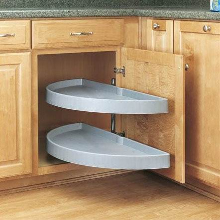 Pildil on köögi nurgakapp, kus uks on lahti ja ukse küljes on poolringi kujuline riiul. 2 tükki.